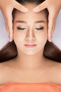 Asian Woman having spa massage of the head Royalty Free Stock Photo