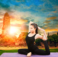 Asian woman health care yoga posting with asian ancient pagoda t Royalty Free Stock Photo