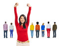 Asian woman with her arms raised back view of multi ethnic people and a Royalty Free Stock Photo