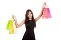 Asian woman hold shopping bags up with both hands isolated on white background Royalty Free Stock Image