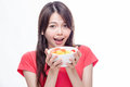 Asian woman holding bowl of fruit Royalty Free Stock Photo