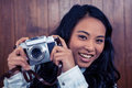 Asian woman holding digital camera Royalty Free Stock Photo