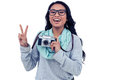Asian woman holding digital camera and making peace sign with hand Royalty Free Stock Photo