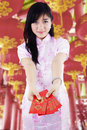 Asian woman holding red packet gift with chinese traditional dress Royalty Free Stock Photos