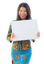 Asian woman holding a white blank card in kebaya kebaya usually worn by in indonesia malaysia brunei burma singapore Stock Photo