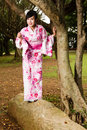 Asian woman in kimono in garden Royalty Free Stock Photo