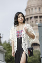 Asian woman in lifestyle locations standing in front of capital building in austin texas Stock Image