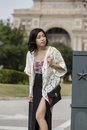 Asian woman in lifestyle locations standing in front of capital building in austin texas Stock Photos