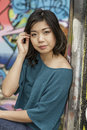 Asian woman in lifestyle locations on street corner Royalty Free Stock Photography
