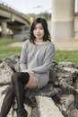 Asian woman in lifestyle locations under a train track overpass Royalty Free Stock Photos