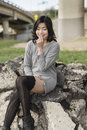 Asian woman in lifestyle locations under a train track overpass Royalty Free Stock Photography