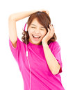 Asian woman listening and enjoying music in headphones studio Royalty Free Stock Images