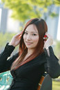 Asian woman listening to the music Stock Photography
