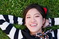 Asian woman lying grass park Royalty Free Stock Photos