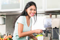 Asian woman making espresso in his kitchen Royalty Free Stock Photo