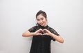 Asian woman making a heart sign with her hands, body language Royalty Free Stock Photo