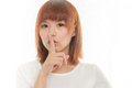 Asian woman making a keep quiet gesture isolated on white attractive habd Royalty Free Stock Image