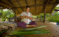 Asian woman making straw mats Royalty Free Stock Photo