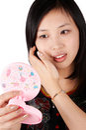 Asian woman at the mirror Royalty Free Stock Photo