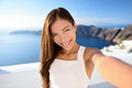 Asian woman model taking beauty makeup selfie on santorini summer travel beautiful young adult mixed race chinese caucasian female Stock Photos
