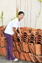 Asian woman move terracotta tiles Stock Image