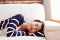 Asian woman napping on the couch Royalty Free Stock Photo