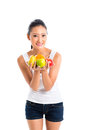 Asian woman offering healthy fruits young for living wearing sportswear Royalty Free Stock Photos