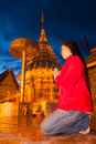 Asian woman pay respect to golden pagoda Stock Photos