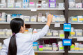 Asian woman a pharmacist in pharmacy room Royalty Free Stock Photo