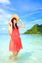 Asian woman in a pink dress standing on the beach Royalty Free Stock Images