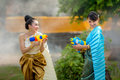 Asian woman playing guns in the Songkran Festival fun. Royalty Free Stock Photo