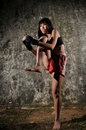 Asian Woman Practising Muay Thai Boxing Royalty Free Stock Photo