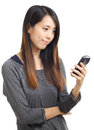 Asian woman read sms on phone isolated white background Stock Photography