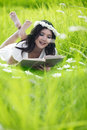 Asian woman reading outdoor Royalty Free Stock Photo