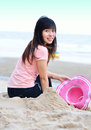 Asian woman relaxation on beach with hat Royalty Free Stock Image