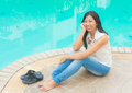 An asian woman relaxing beside a swimming pool present for relaxation activity in urban life style Royalty Free Stock Photo