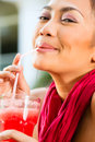 Asian woman in restaurant drinking Stock Photography