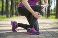 Asian woman runner hold Knee Pain ,Human Leg Royalty Free Stock Photo