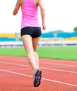 Asian woman runner running in sports ground outdoor Royalty Free Stock Photography