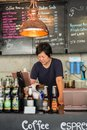 Asian woman work as cashier service in coffee shop Royalty Free Stock Photo