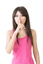 Asian woman saying hush be quiet isolated over white Stock Photography