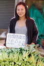 Asian woman seller Stock Image