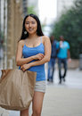 Asian woman shopping in the city Royalty Free Stock Photo