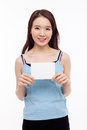 Asian woman showing empty card Royalty Free Stock Photography