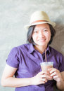 Asian woman smiling in coffee shop Royalty Free Stock Photo