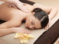 Asian woman in spa health and beauty resort and relaxation concept salon getting massage Royalty Free Stock Images