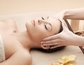 Asian woman in spa health and beauty resort and relaxation concept salon getting massage Stock Image
