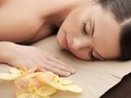 Asian woman in spa health and beauty resort and relaxation concept salon lying on the massage desk Royalty Free Stock Images