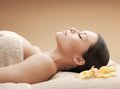 Asian woman in spa health and beauty resort and relaxation concept salon lying on the massage desk Royalty Free Stock Image