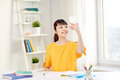 Asian woman student taking selfie with smartphone Royalty Free Stock Photo